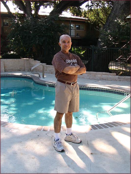 Adan in chocolate tshirt by pool