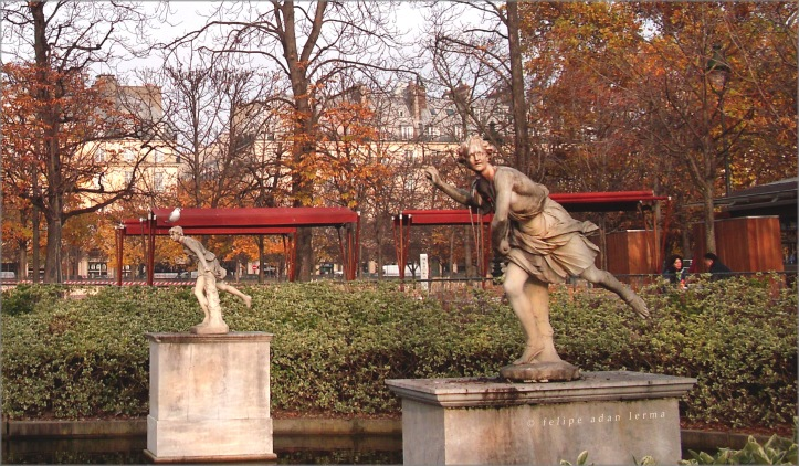 Running Statues at Tuileries with Bird on Head
