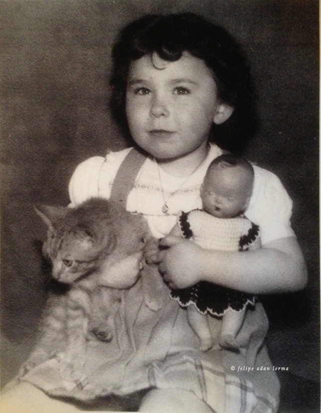 Sheila with her cat and doll.