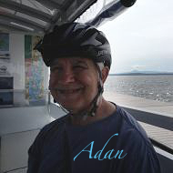 Artist self portrait - photo of Felipe Adan Lerma on converted railway track bike ferry for the Island Line Trail connecting mainland Vermont to South Hero on Lake Champlain.