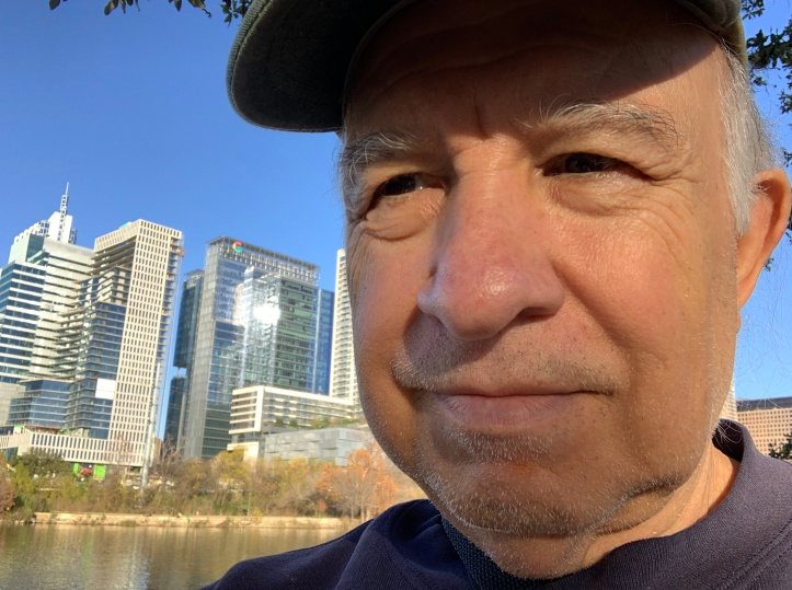 Self portrait - Felipe Adan Lerma, along Lady Bird Lake with partial Austin Texas skyline in background. Part of my self portrait collection at - xxxxx .