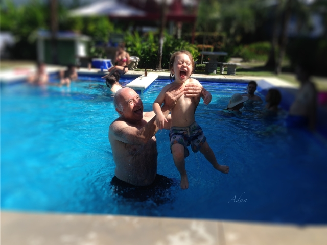 Image of myself with you ingest grandchild in pool in Costa Rica. This is a sample artist self portrait image from my collection at Fine Art America - https://fineartamerica.com/profiles/felipeadan-lerma.html?tab=artworkgalleries&artworkgalleryid=746647 .