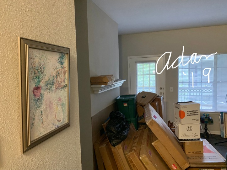 First painting on the wall from boxes of images during our recent move to a new location. Painting is, My Cat's World © Felipe Adan Lerma