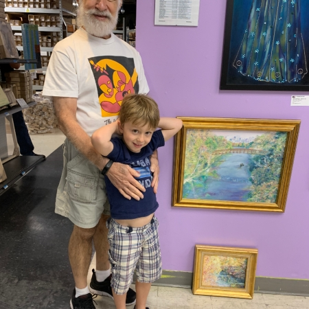 Adan & grandson at Jerry's Artarama 2019 U.S. Veteran's Art Show Reception w/his two replacement paintings that sold that night