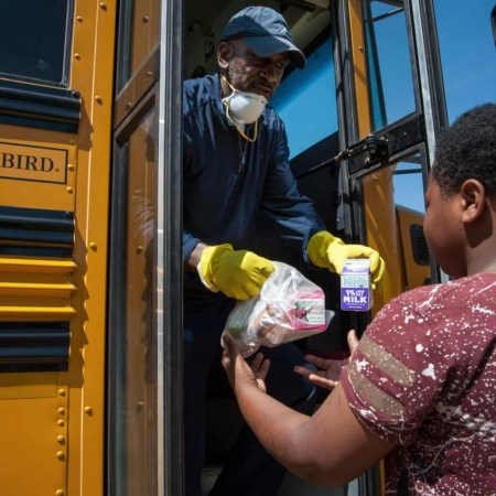 Robert King, transportation supervisor for Holmes county consolidated school district, delivers school lunches to student Keizarrian Thomas, in Lexington, Mississippi, on 1 April. Photograph: Rory Doyle/The Guardian https://www.theguardian.com/world/2020/apr/06/in-the-poorest-county-in-americas-poorest-state-a-virus-hits-home-hunger-is-rampant