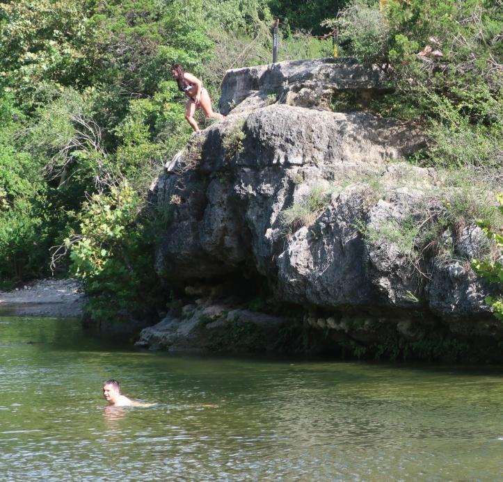 Payton jumping into Barton Springs 08.08.21